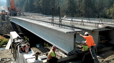 136.8-ft.-long prestressed concrete super girders for the new Miles Creston Bridge in Lincoln County, Wash., are 58 in. tall with 49-in.-wide top flanges to maximize span length, minimize the number of girders and allow clearance above the river for a 100-year flood.
